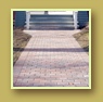 New brick path leads to front entrance of classic brick home