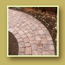 Tapered cuts take a cobblestone path smoothly around a corner