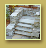 Square cut flagstone wall and stairs are a timeless, classic and formal look